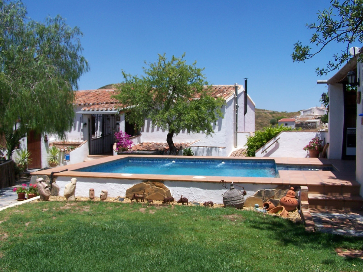 A traditional finca (Cortijo) spread over approx. 2 acres of land in the village of Lubrin.   The pr,Spain