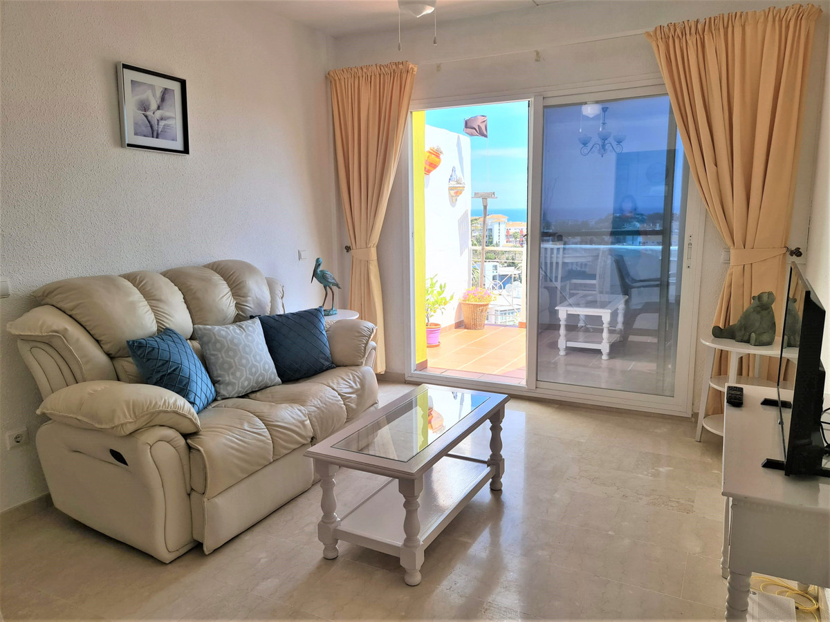 Lovely bright 2 bedroom 2 bathroom top floor apartment with panoramic sea views situated in a gated ,Spain