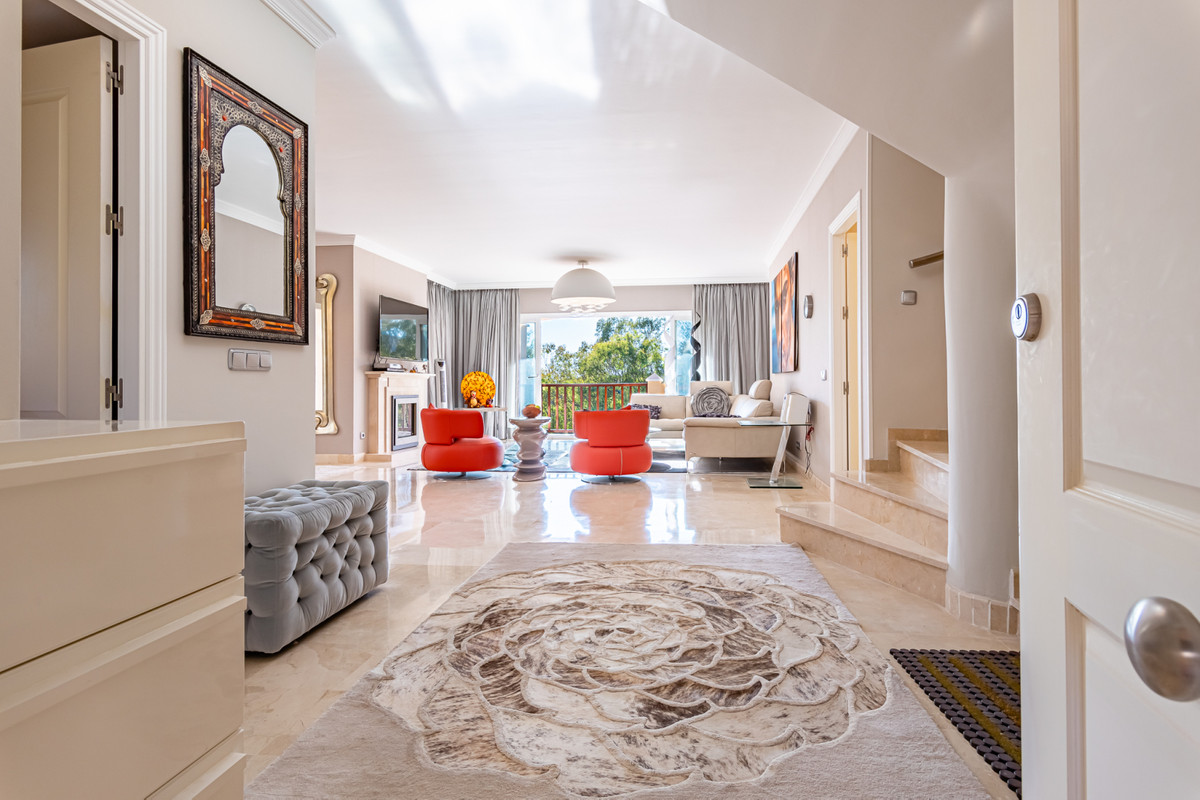 This penthouse is located within a luxury Marques de Atalaya complex on the first line of golf and f,Spain