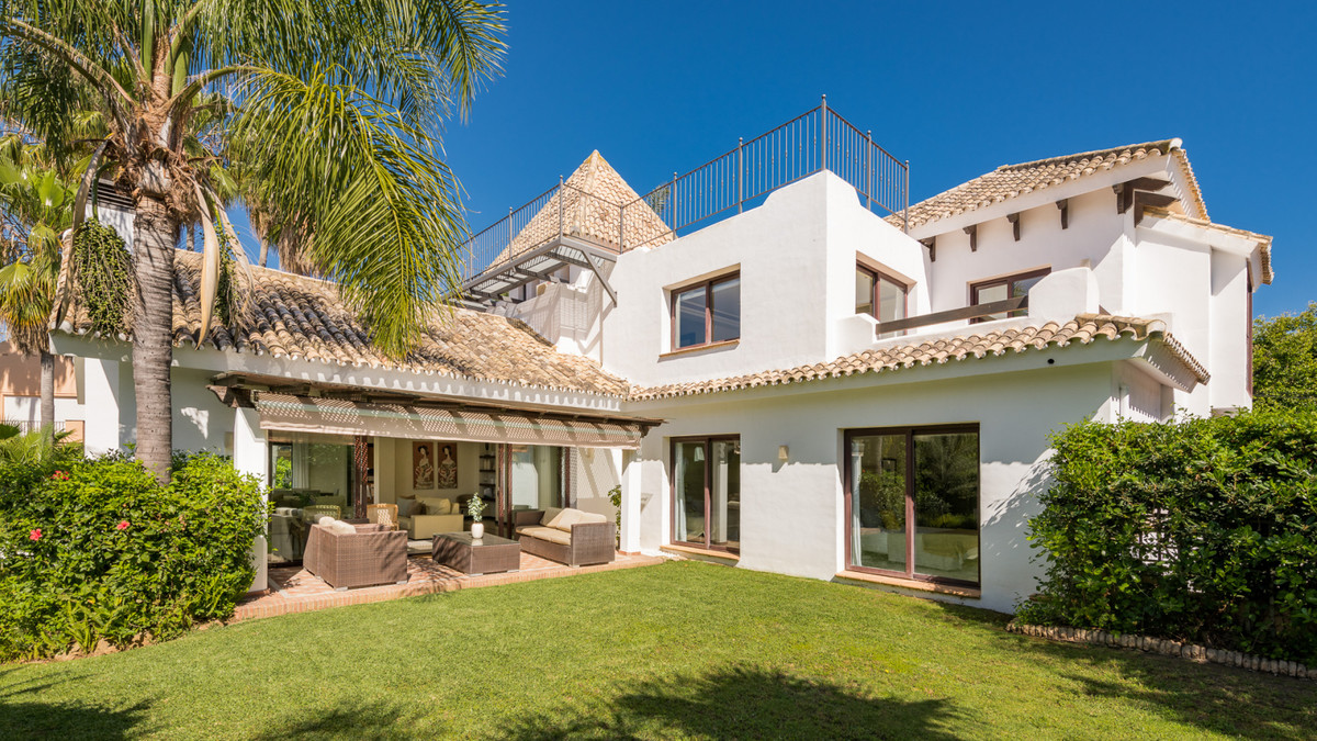 This impressive villa is located in a tranquil yet central residential area in Marbella east. Built ,Spain