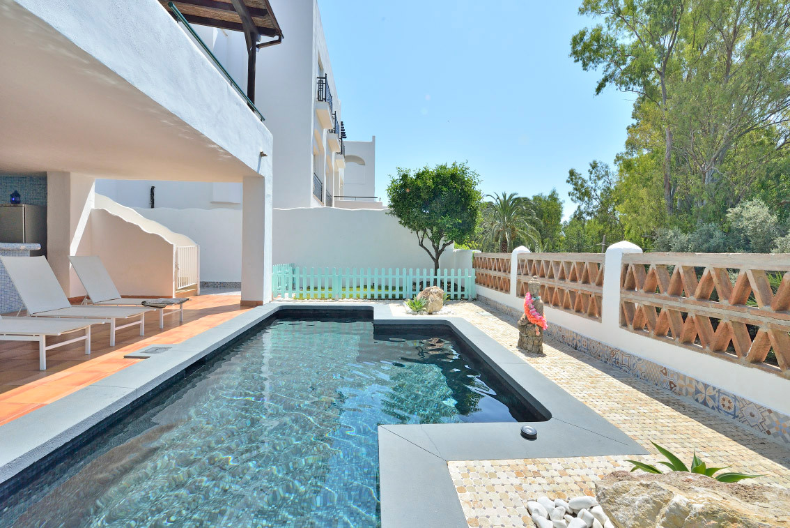 Beautiful detached villa with large terraces and private swimming pool and garden located in the urb,Spain