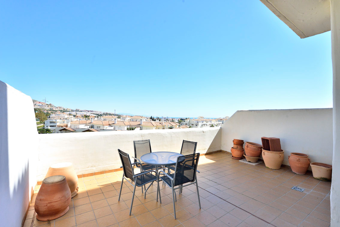 Cozy apartment with a large terrace, facing East with views to the community swimming pool, part of ,Spain