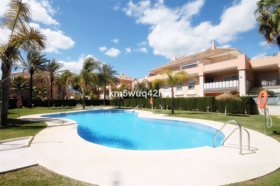 Part of a privileged beachside secure community, this fabulous ground floor apartment offers a large, Spain