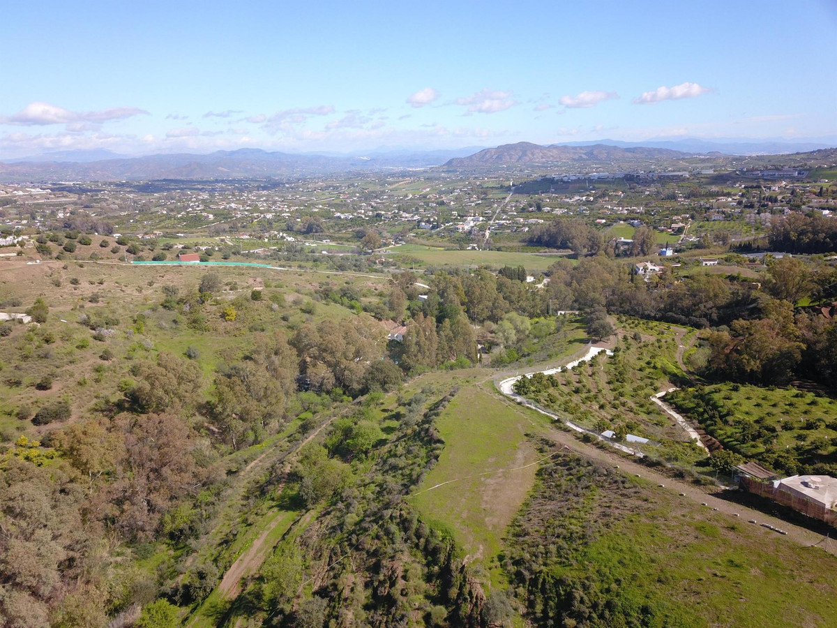 14.500m2 rustic plot (irrigated) located between Alhaurin el Grande and Coin (Las Lomas).  The plot , Spain