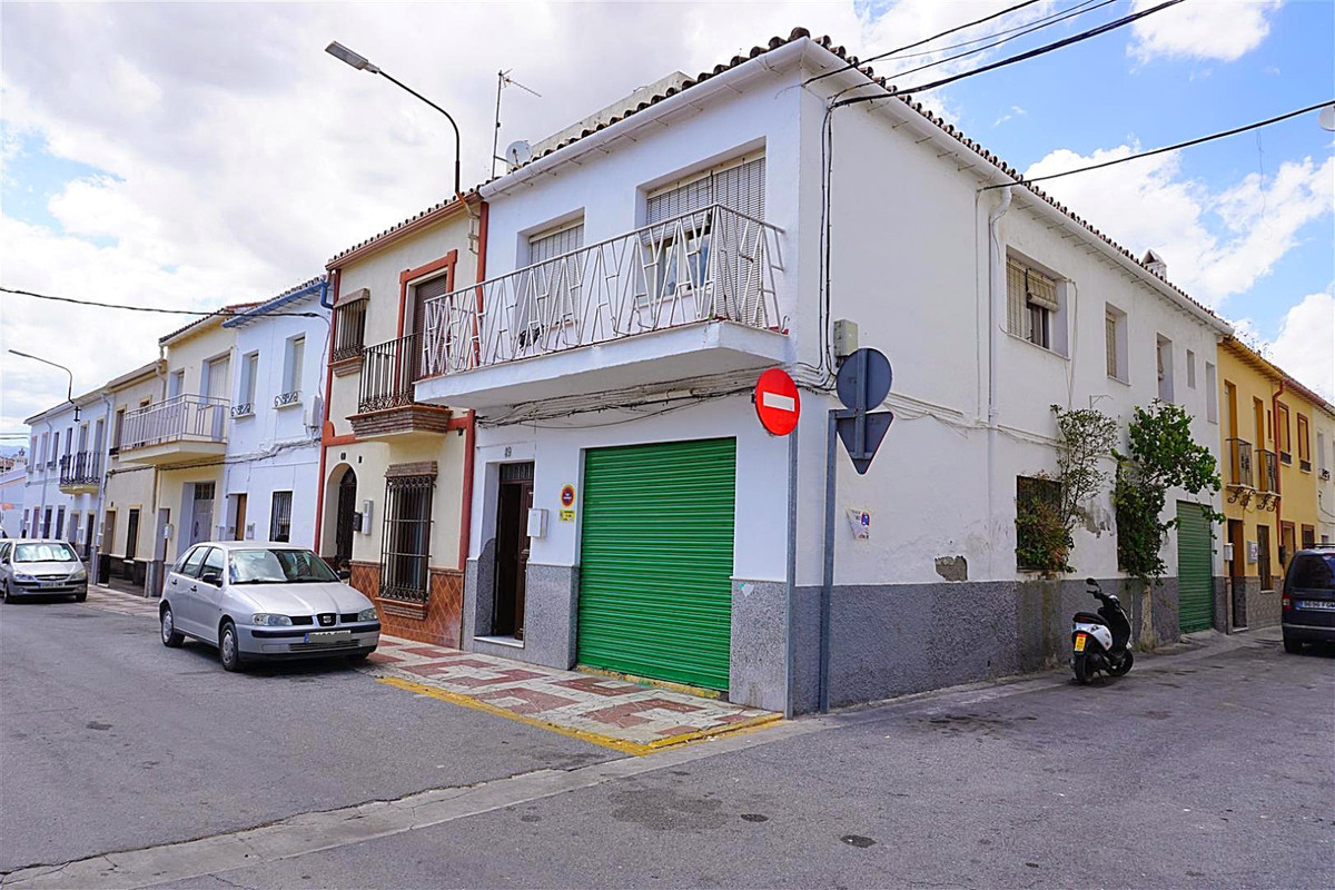 This spacious corner house is in the centre of Coin but in a quiet residential area with a large gar, Spain