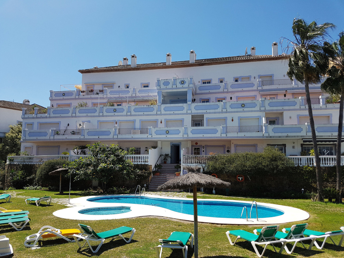 In a gated complex, with gardens and common pool, and with restaurants, supermarket, pharmacy, haird, Spain