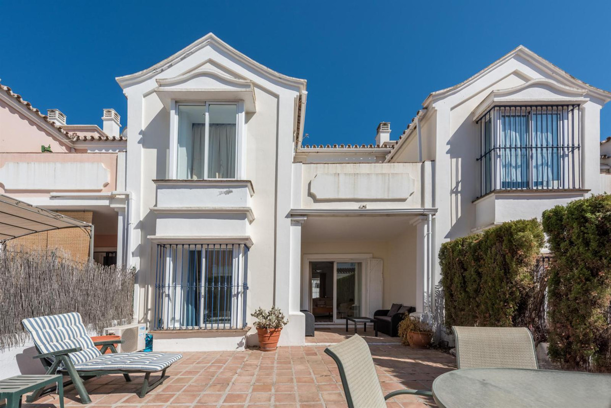West facing duplex townhouse with a large private patio with easy access to communal pool. Situated ,Spain