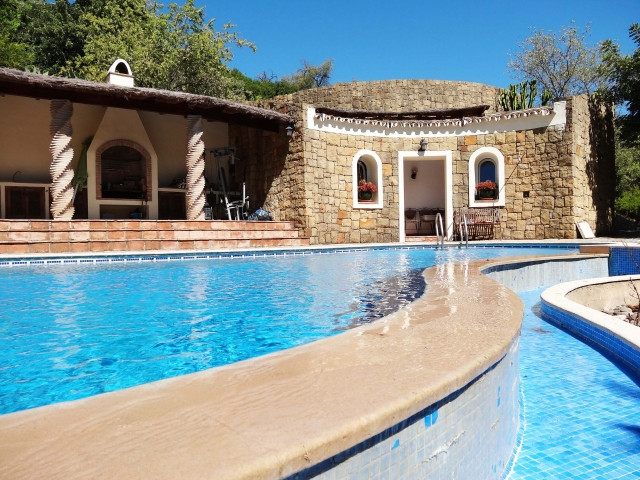 This luxury country property is located near to the famous white village of Gaucin and would make ei,Spain