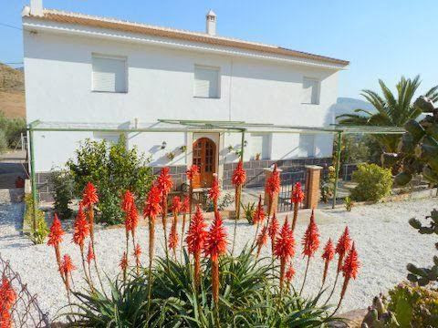 Two houses for sale, incorporating a readymade holiday rental business.  La Huertecilla is a 280sqm , Spain