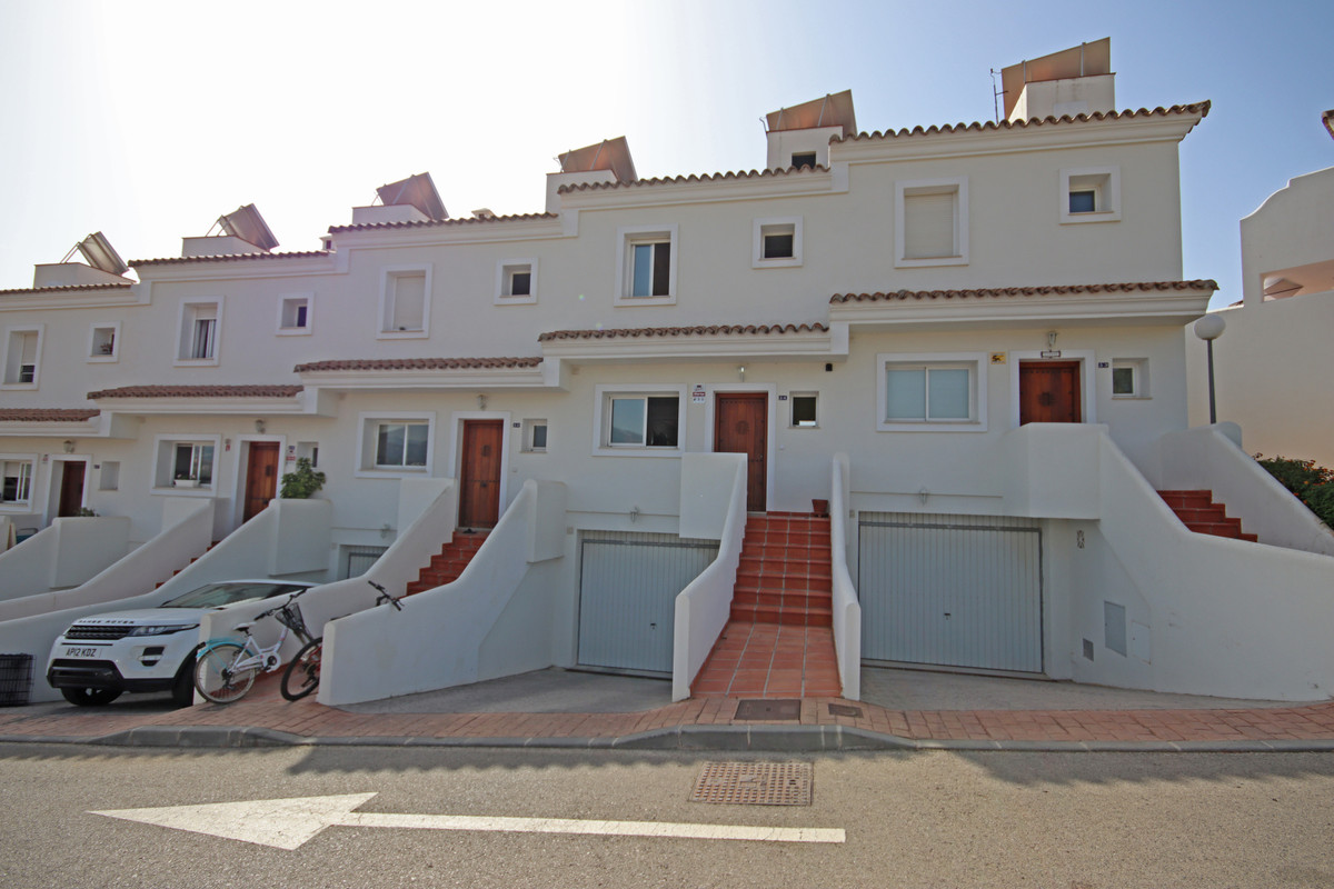 Exceptional and beautifully decorated three double bedroom townhouse on this small prestigious gated, Spain