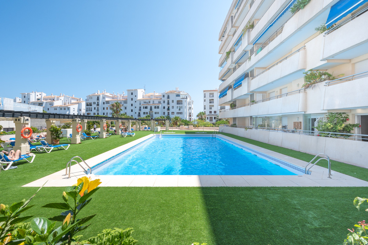 In the center of Puerto Banus, property with 2 bedrooms, 2 full bathrooms, living room with access t,Spain