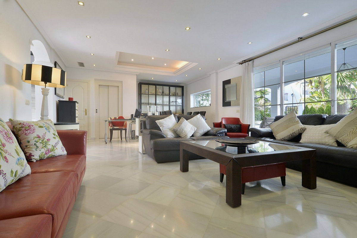 Lovely five bedroom bright and ample townhouse totally refurbished within a closed complex in one of,Spain