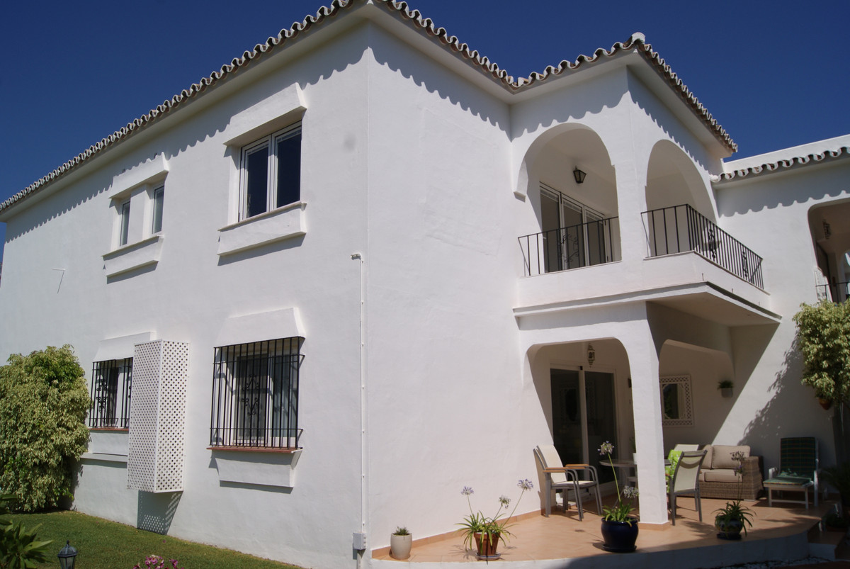 Stunningly renovated two bedroom, two bathroom top floor apartment in tranquil complex overlooking E,Spain