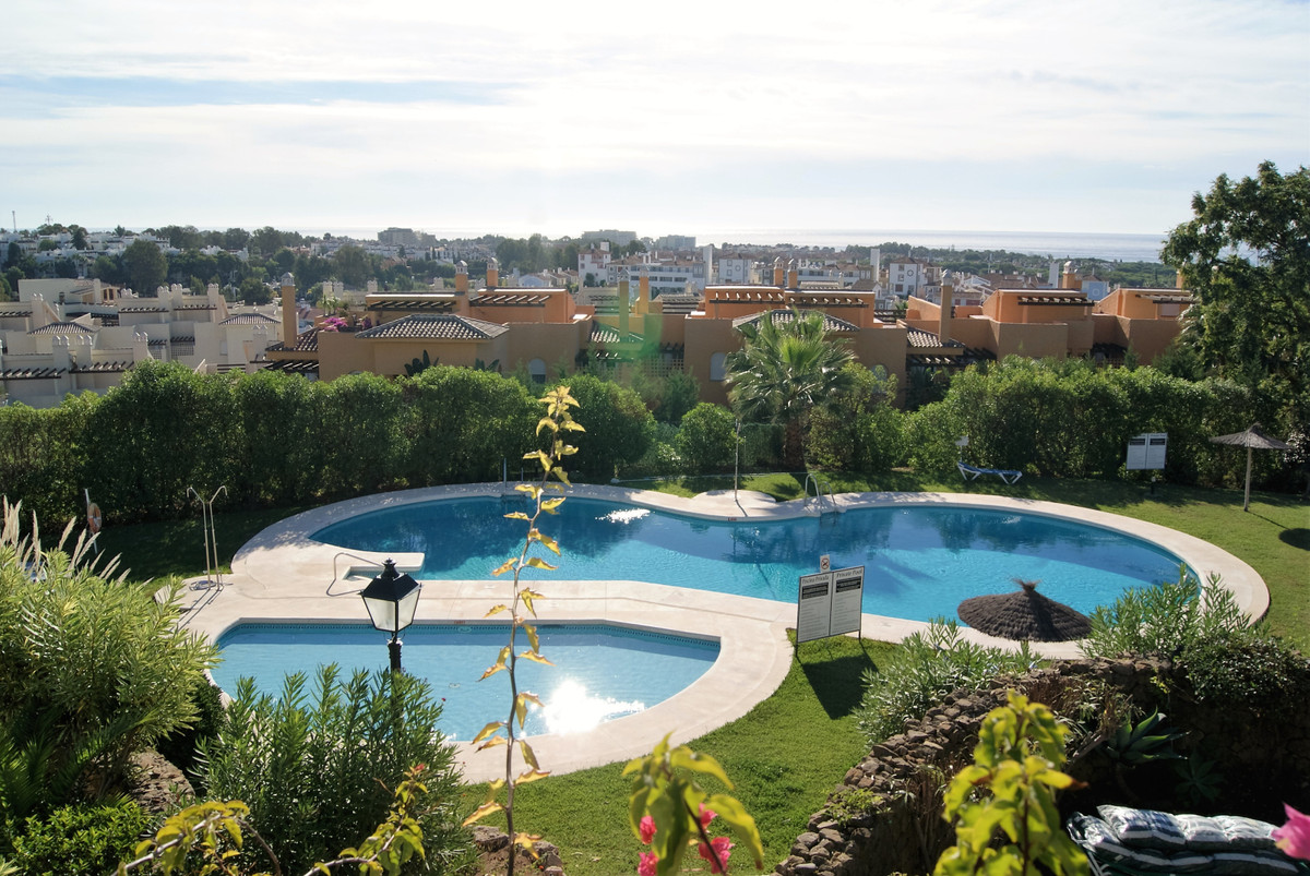 Two bedroom, two bathroom corner apartment on first floor of a prestigious residential complex withi, Spain