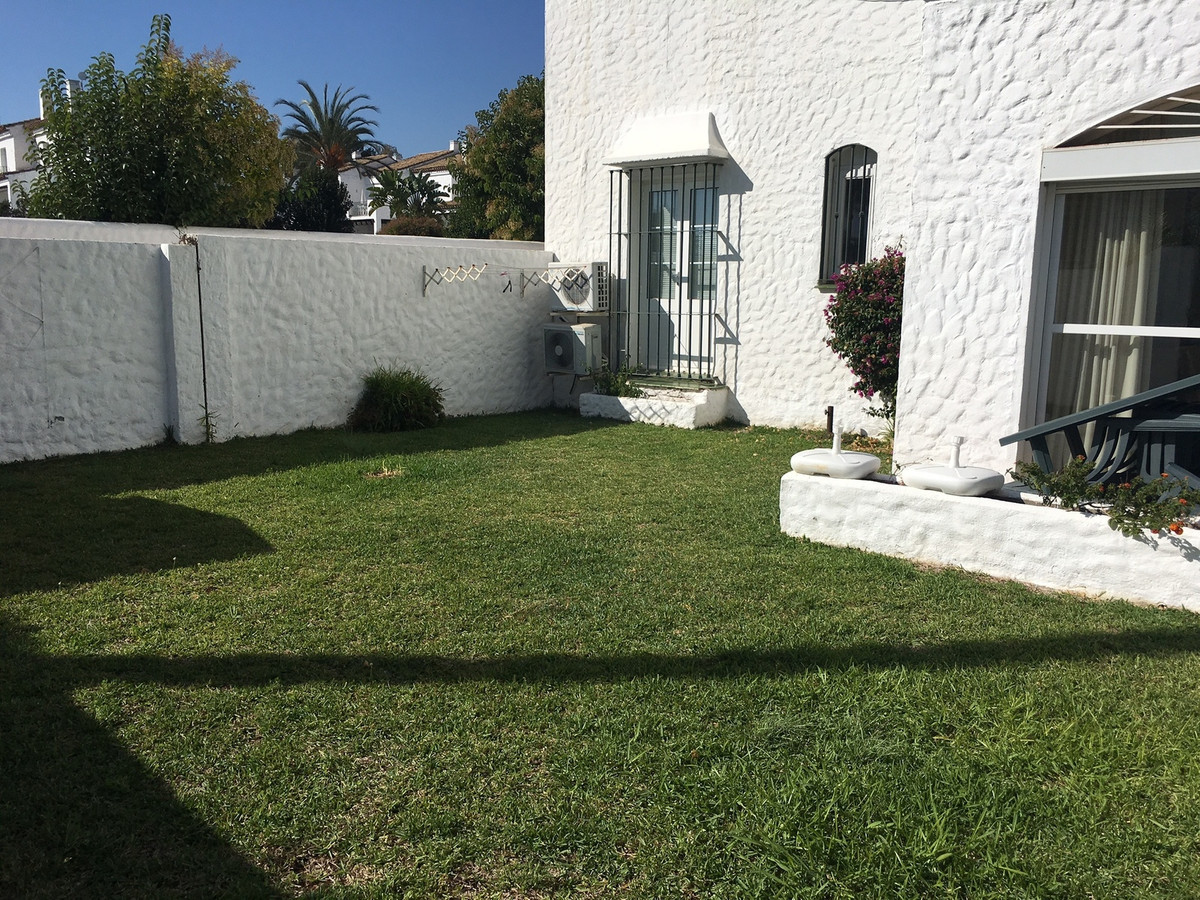 Sunny corner garden apartment in popular location within easy walking distance of shops, restaurants, Spain
