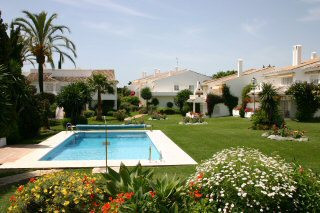 Two bedroom garden apartment with beautiful views to the community gardens and heated pool enjoying ,Spain