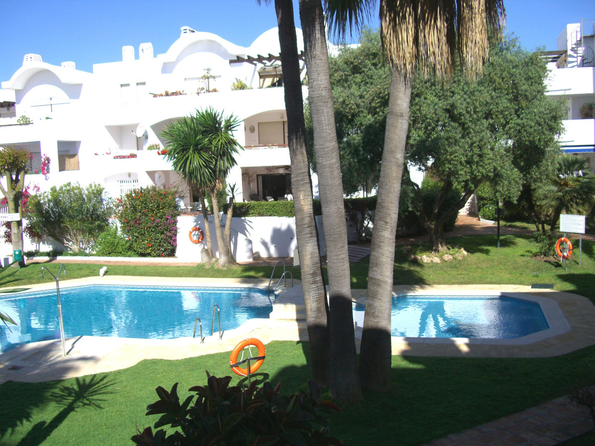 Spacious two bedroom, two bathroom first floor apartment in gated residential complex close to ameni, Spain