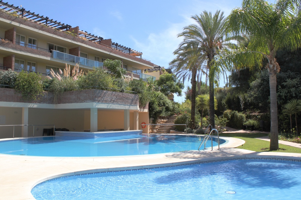This 2 bedroom luxury south east facing 1st floor apartment with mountain views is situated within t, Spain