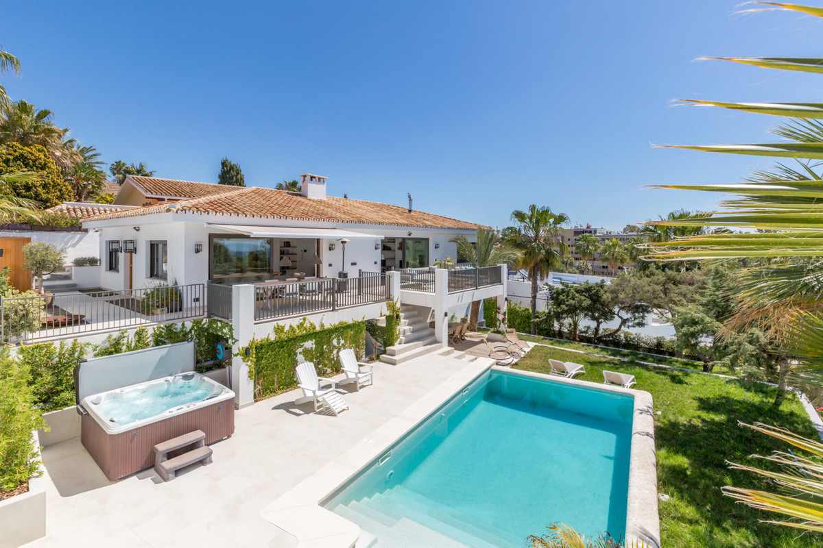 A villa where Spanish architecture is combined with modern design.   This property has recently comp,Spain