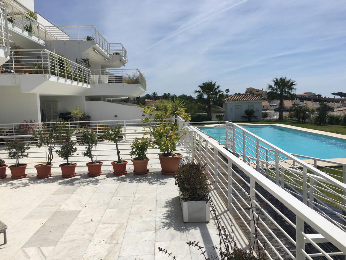 Sunny 2 bedroom apartment with huge terrace. Large communal pool with salt water.  Lovely bright sun, Spain