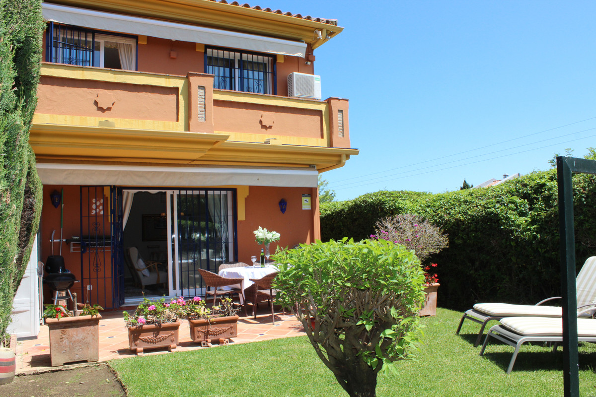 This is a bright corner townhouse in a central position in a small and fully gated community on the ,Spain
