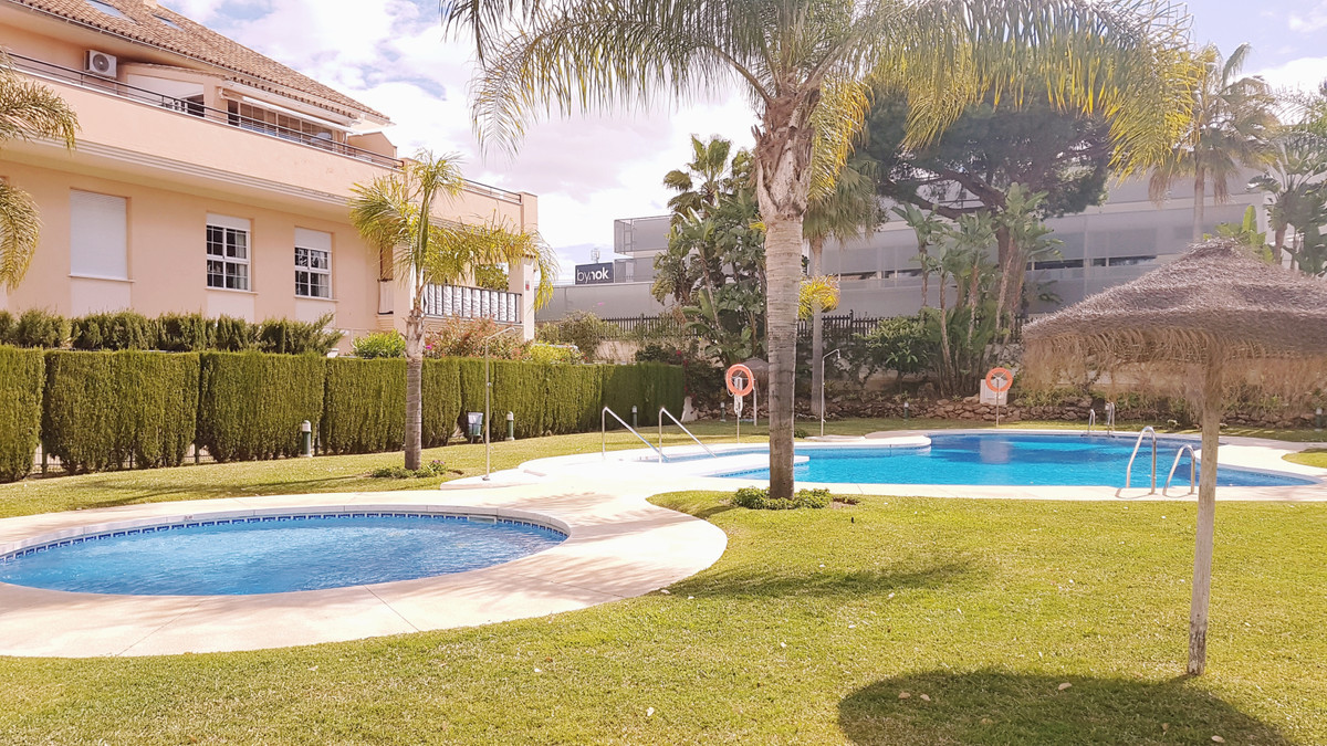 Side Beach  Beautiful apartment with lots of light and private garden in a nice complex closed with , Spain