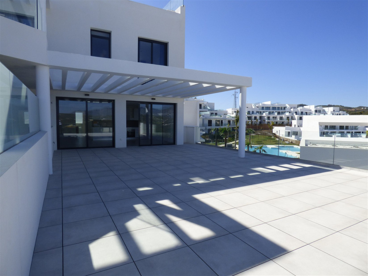 SUN ALL DAY.   Corner unit, 3 bedroom two bath in a new development only 900 meters from the sea and,Spain