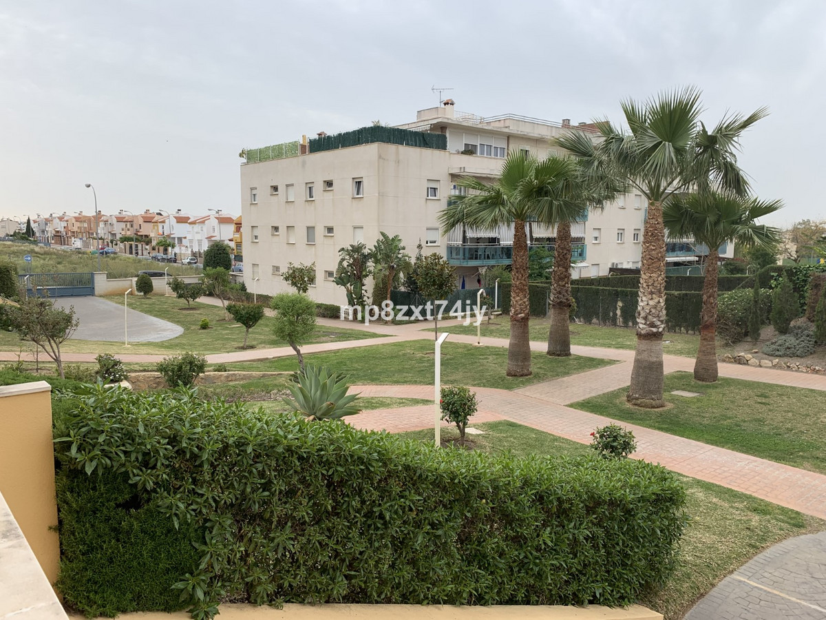 A fantastic ground floor 2 bed apartment in Velez-Malaga with a large terrace, communal pool and gar,Spain