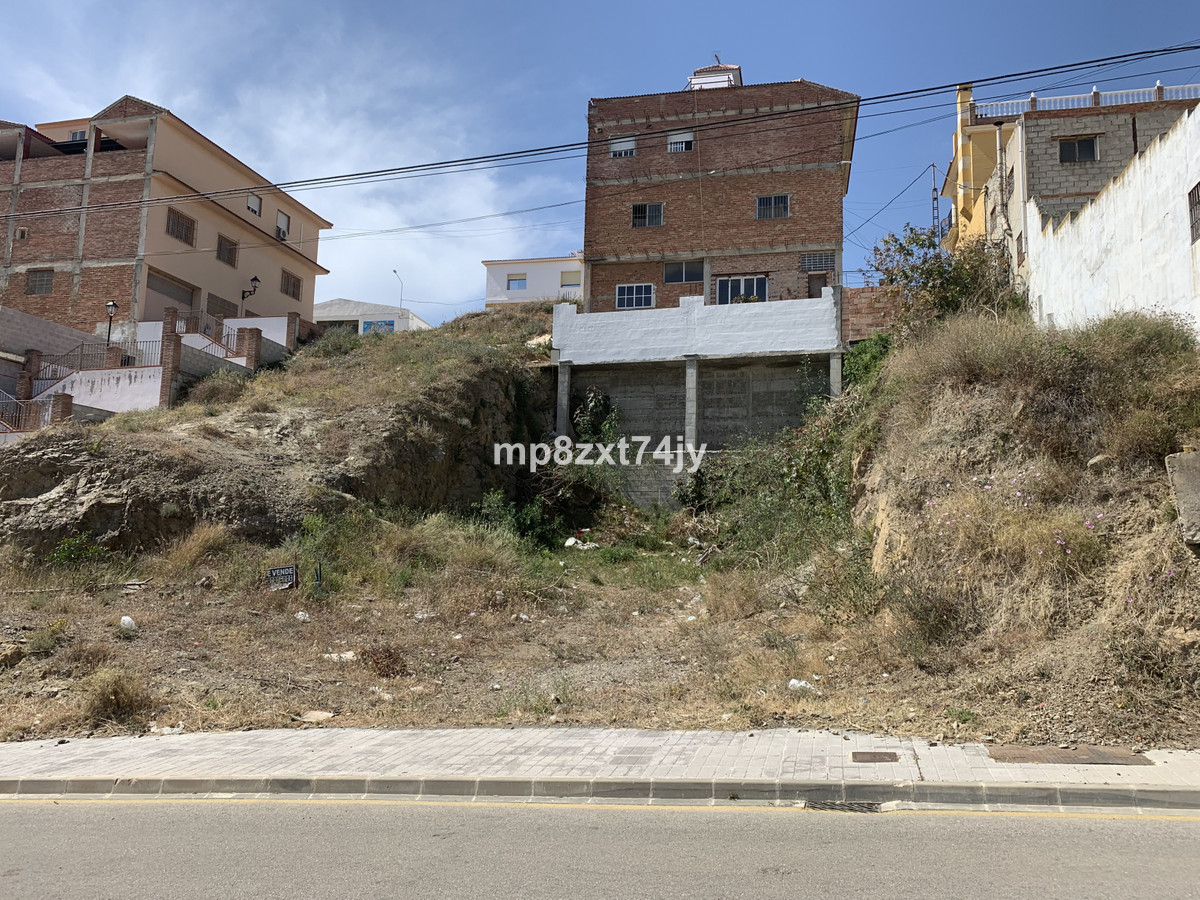 A fantastic opportunity to purchase a residential plot with a sea view in the thriving modern town o,Spain