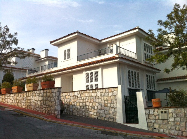 Modern corner villa with private garden and sea views in Rancho Domingo The corner house and has two, Spain