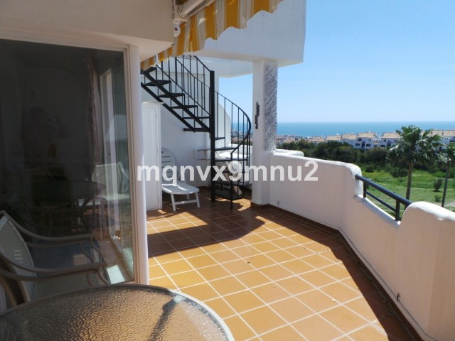 This spacious duplex apartment enjoys stunning sea views.  It is close to some very popular bars and,Spain