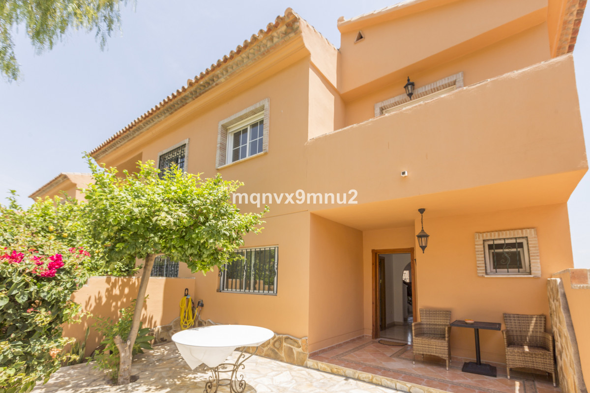 This spacious 4 bedroom town house has 3 double bedrooms upstairs and 1 large bedroom on a lower lev,Spain