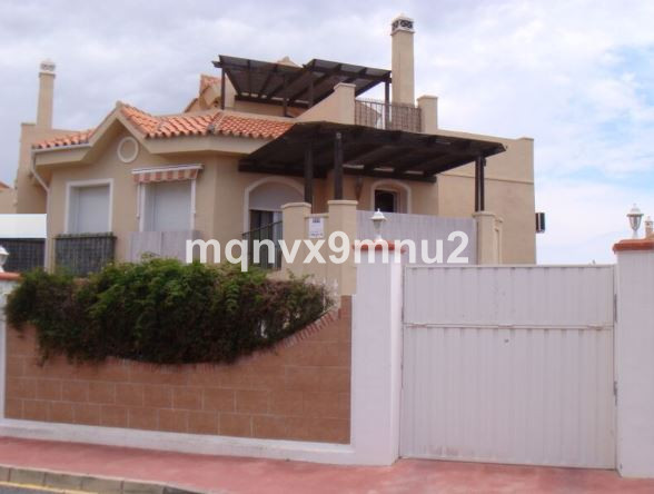 This detached villa is conveniently located in Riviera del sol.  It enjoys private gardens, with pea,Spain