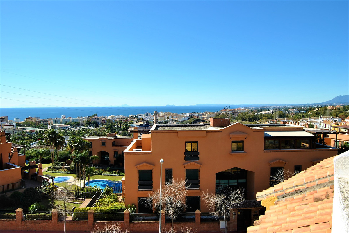 COZY TOWN HOUSE WITH SEA AND MOUNTAIN VIEWS IN GATED COMPLEX.  The house is distributed on 3 floors ,Spain