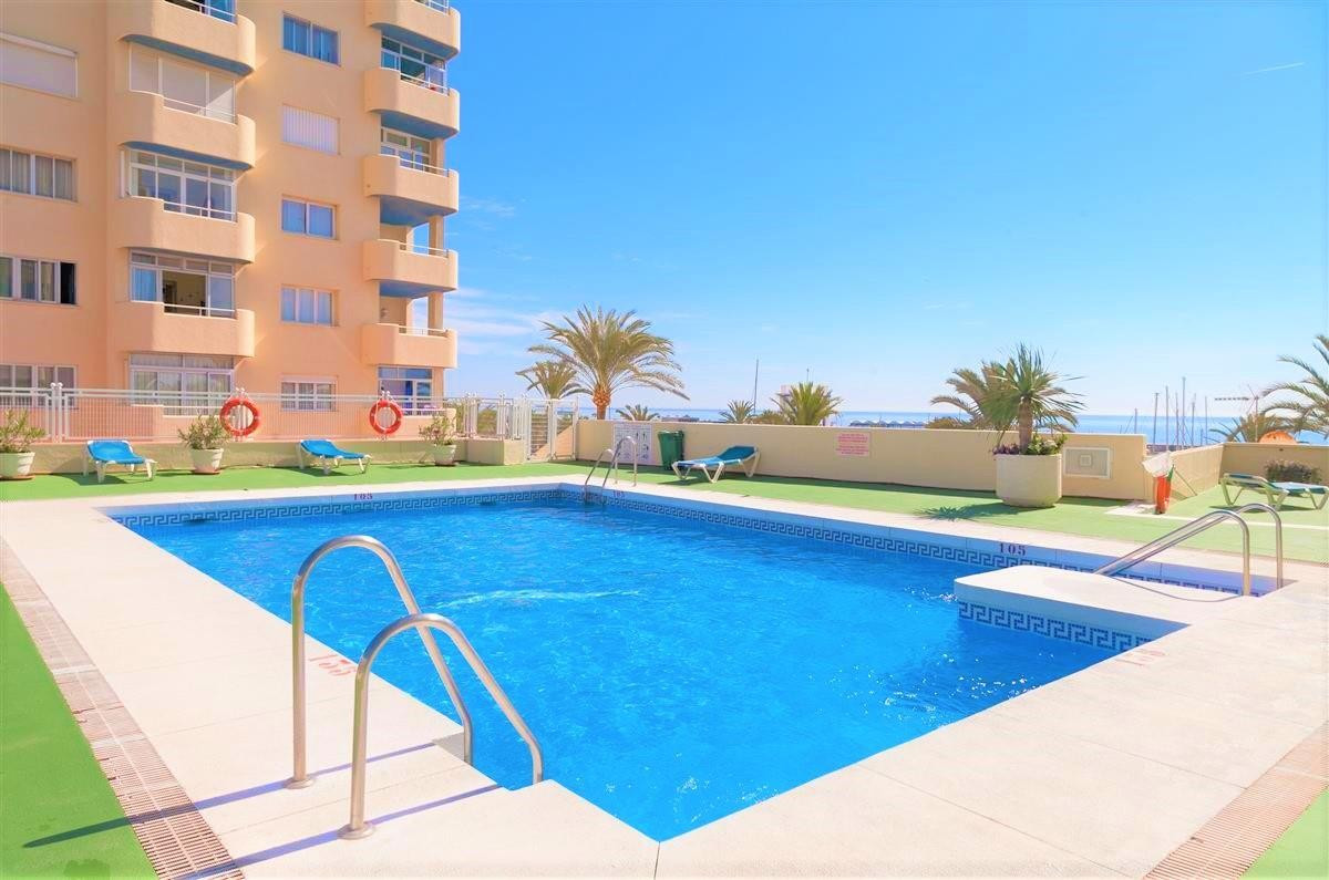 Ground floor two bedroom, two bathroom apartment in the marina of Estepona.  Modernised to a good st,Spain