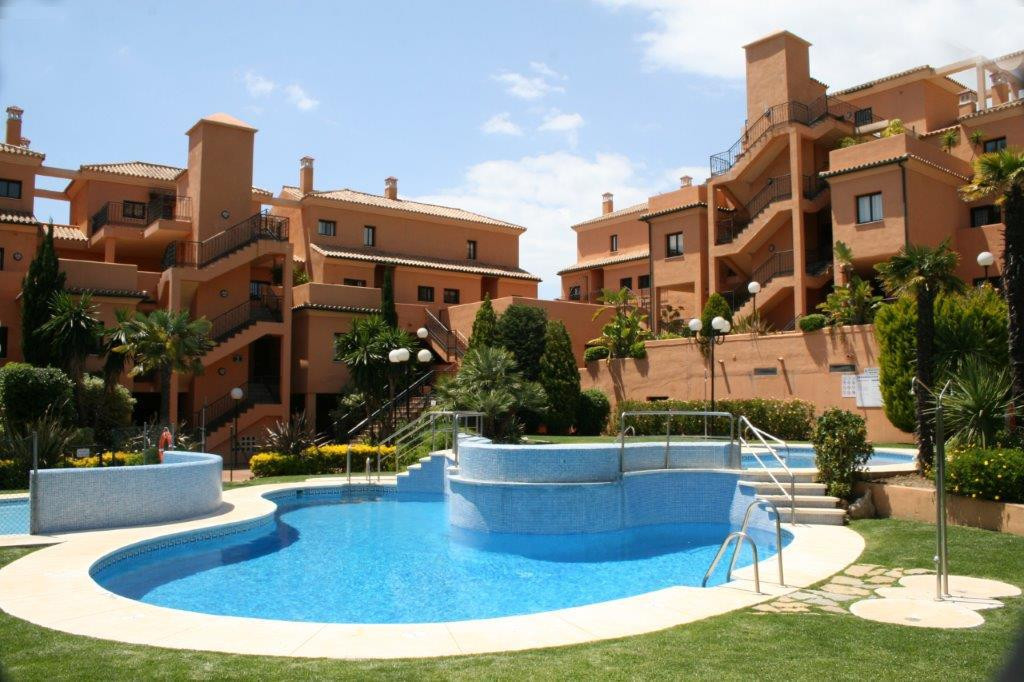 Excellent penthouse duplex set within a gated community with private mature gardens well maintained , Spain