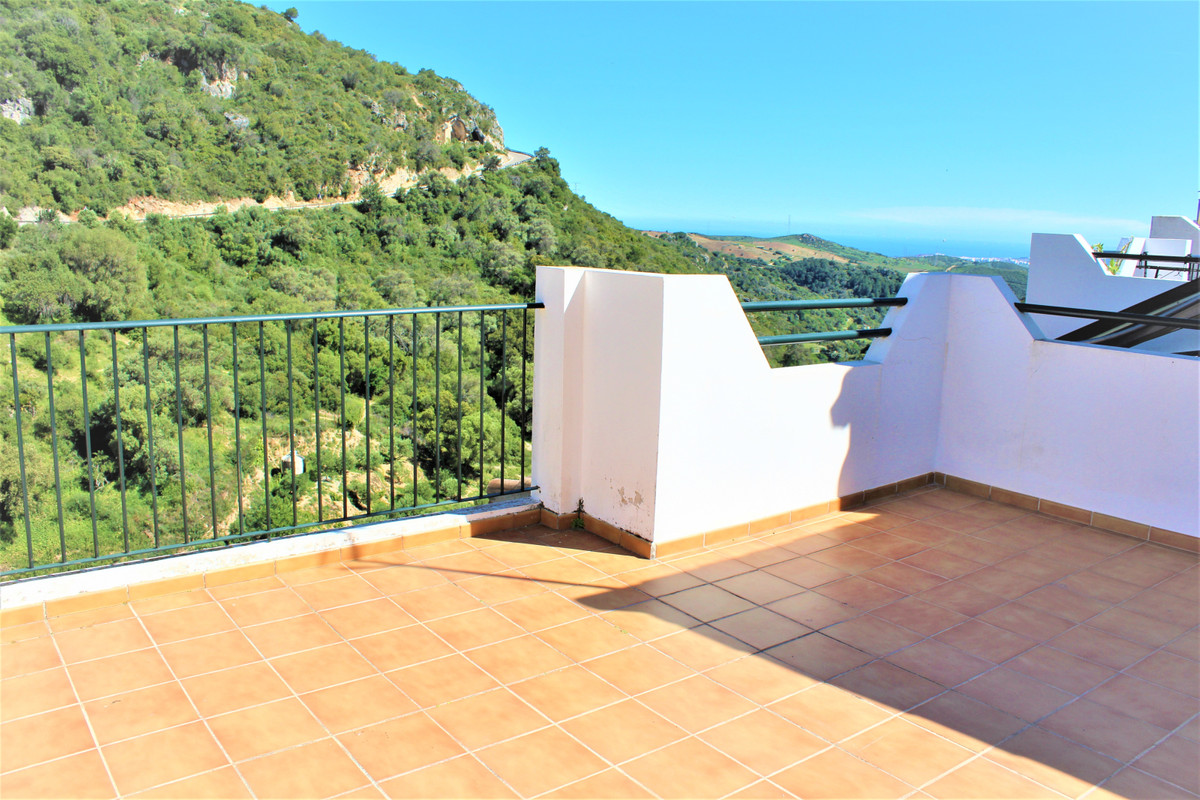 Nested in the cove of the mountains in the ornamental town of Casares this prestigious three bedroom, Spain