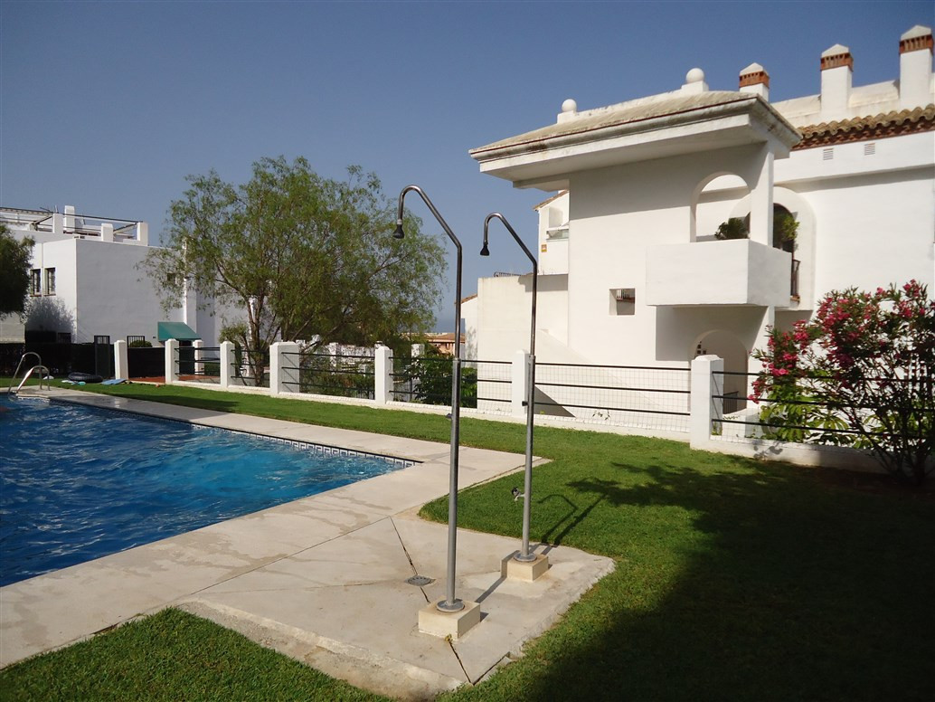 Andalusian pueblo style apartment in Torremolinos.  This fantastic property is located in Montemar. ,Spain