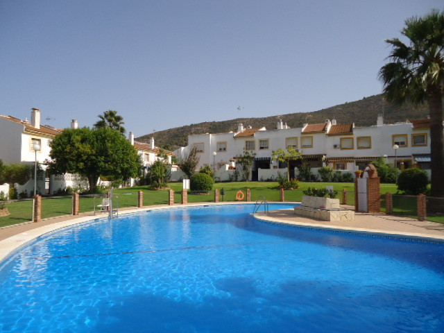 Townhouse in Retamar. This bright and spacious property would make an ideal family home due to its c,Spain