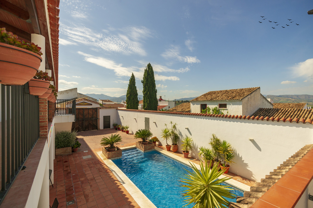 This large village property has been completely rebuild and converted into the most sublime rural to, Spain