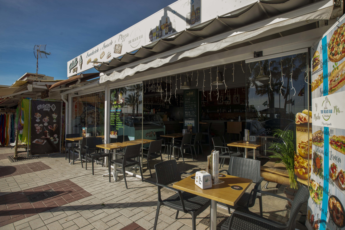 Beachfront Cafe Bar on the beach in the centre of the paseo maritimo (promenade) Torremolinos. Surro, Spain