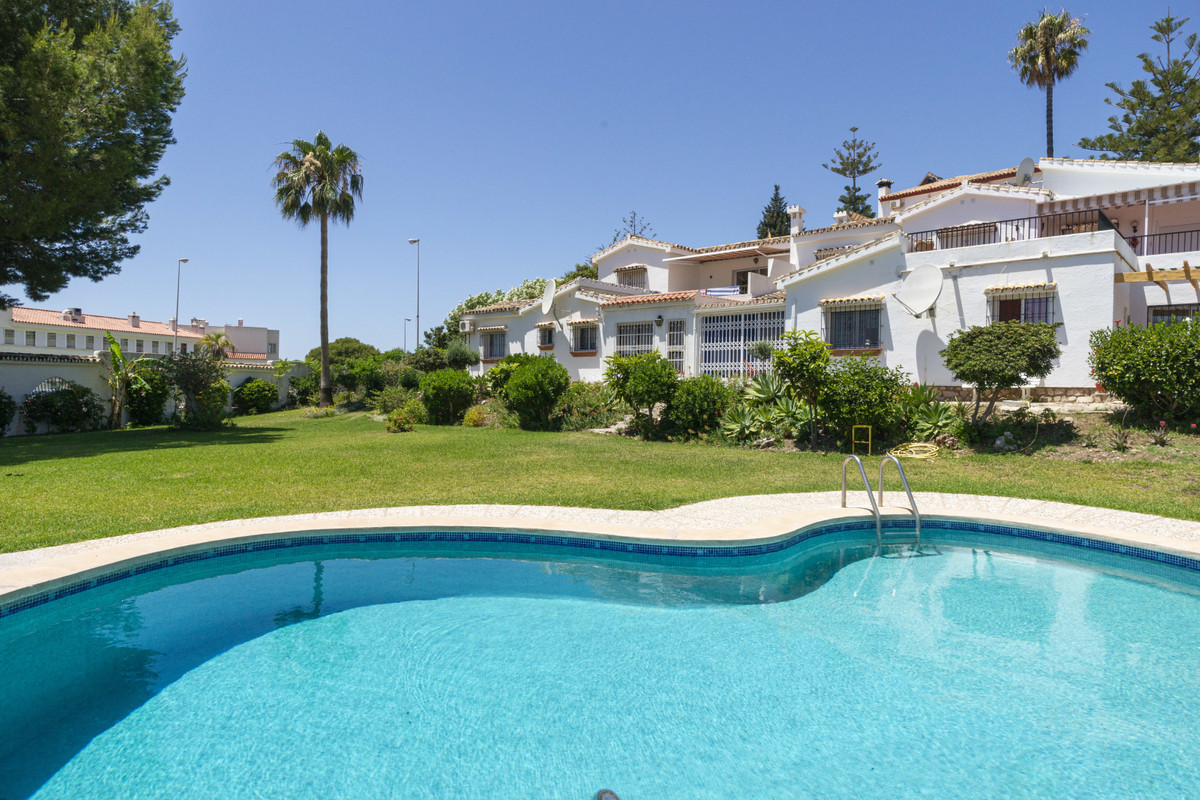 Well presented semi-detached bungalow property with sea views and just a short walk from the beach. , Spain