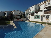 Fantastic 2 bedroom townhouse with large sunny terrace located in Torremolinos.  It has a fabulous community pool and gardens and is walking distance to all amenities and of the beaches of  La Carihuela. It sold with a large independent garage.