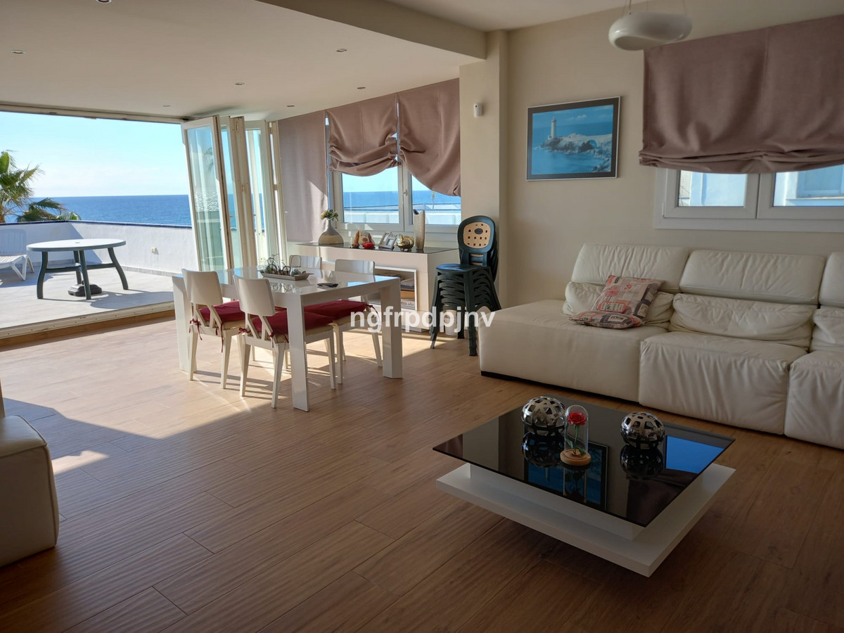 This bright modern 3 bedroom beachfront penthouse is as close as you will get to the sea without act,Spain