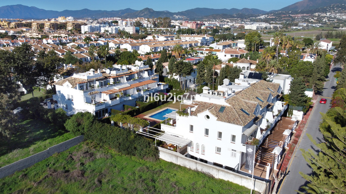 Situated beachside in Cortijo Blanco lies this spacious townhouse built on three levels. Just 600m w, Spain