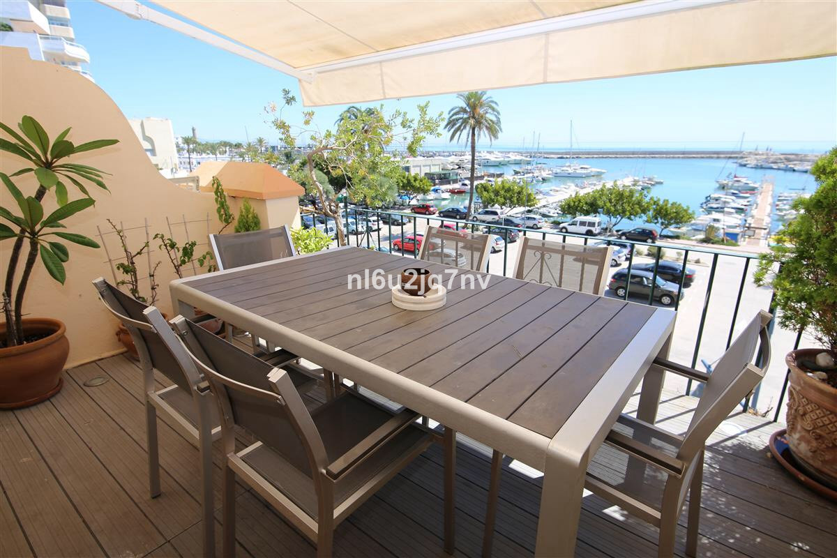 ESTEPONA FRONTLINE BEACH. A fantastic south facing three double bedroom townhouse. The property is a,Spain
