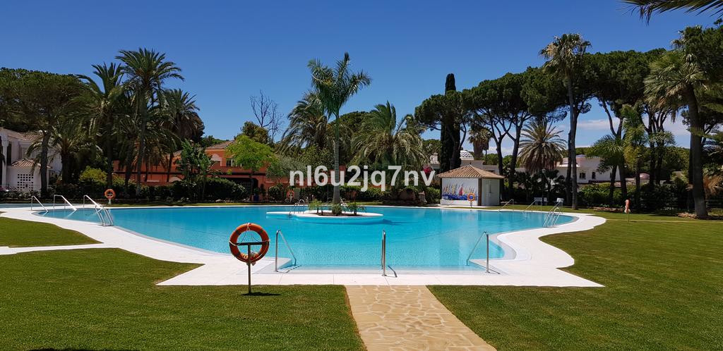 Spacious three double bedroom ground floor garden apartment situated on this beachside development a, Spain