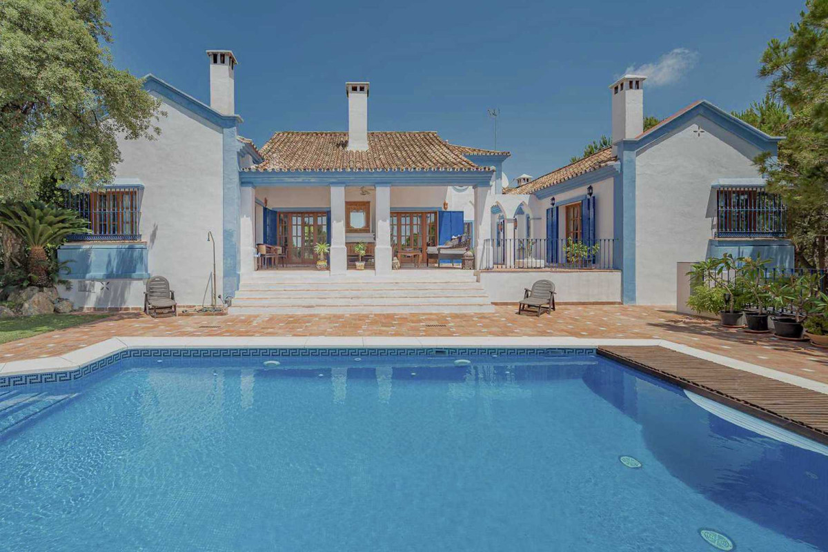 For sale, very attractive, one level Andalusian style villa with separate guesthouse tucked away in ,Spain