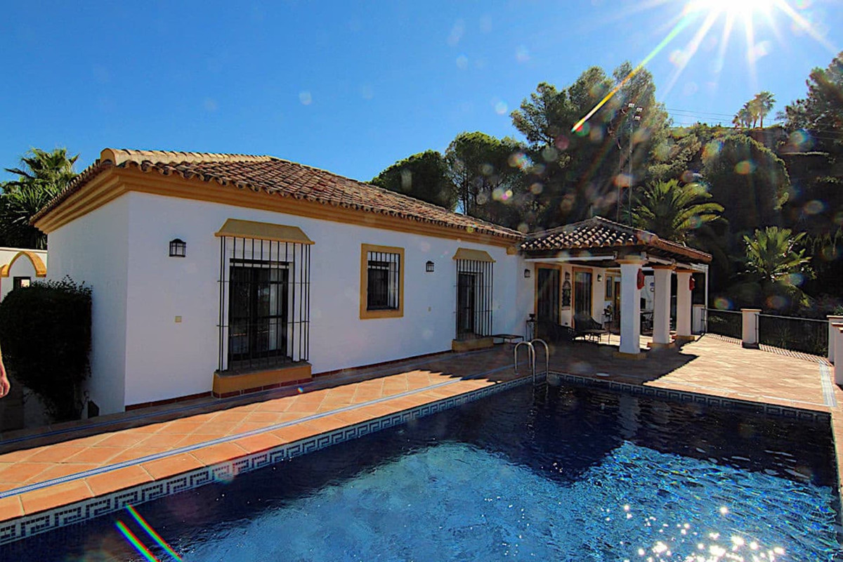 Living on one level in a prestigious urbanisation   This detached home in el Madronal has a rustic a,Spain
