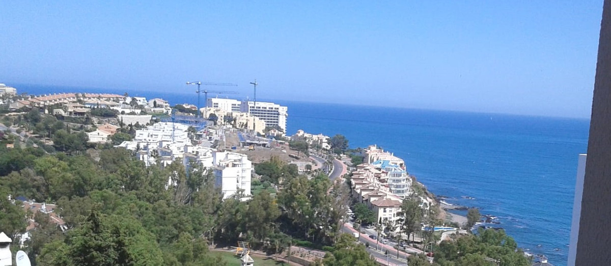 Apartment with golf and sea views. Distributed in living room with exit to the terrace of 12m2, two ,Spain